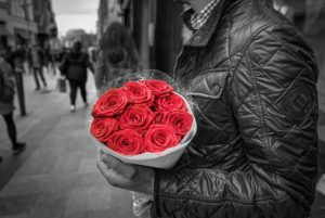 man holding red rose